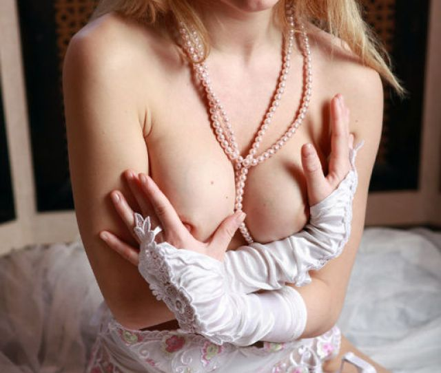 Beautiful Bottomless Blonde Babe In White Stocking