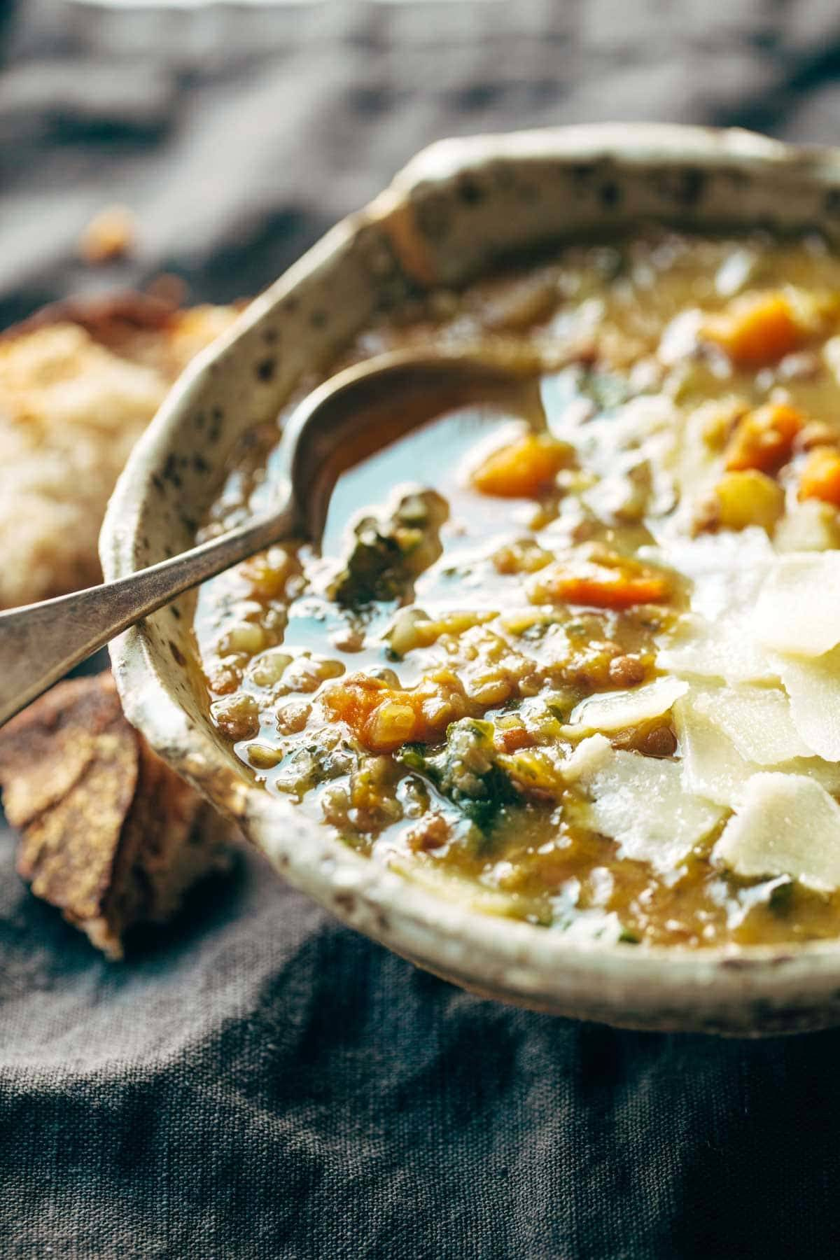 Detox Crockpot Lentil Soup - a nourishing and easy soup recipe made with onions, garlic, carrots, kale, olive oil, squash, and lentils. Vegan / vegetarian / gluten free and SUPER delicious!   pinchofyum.com