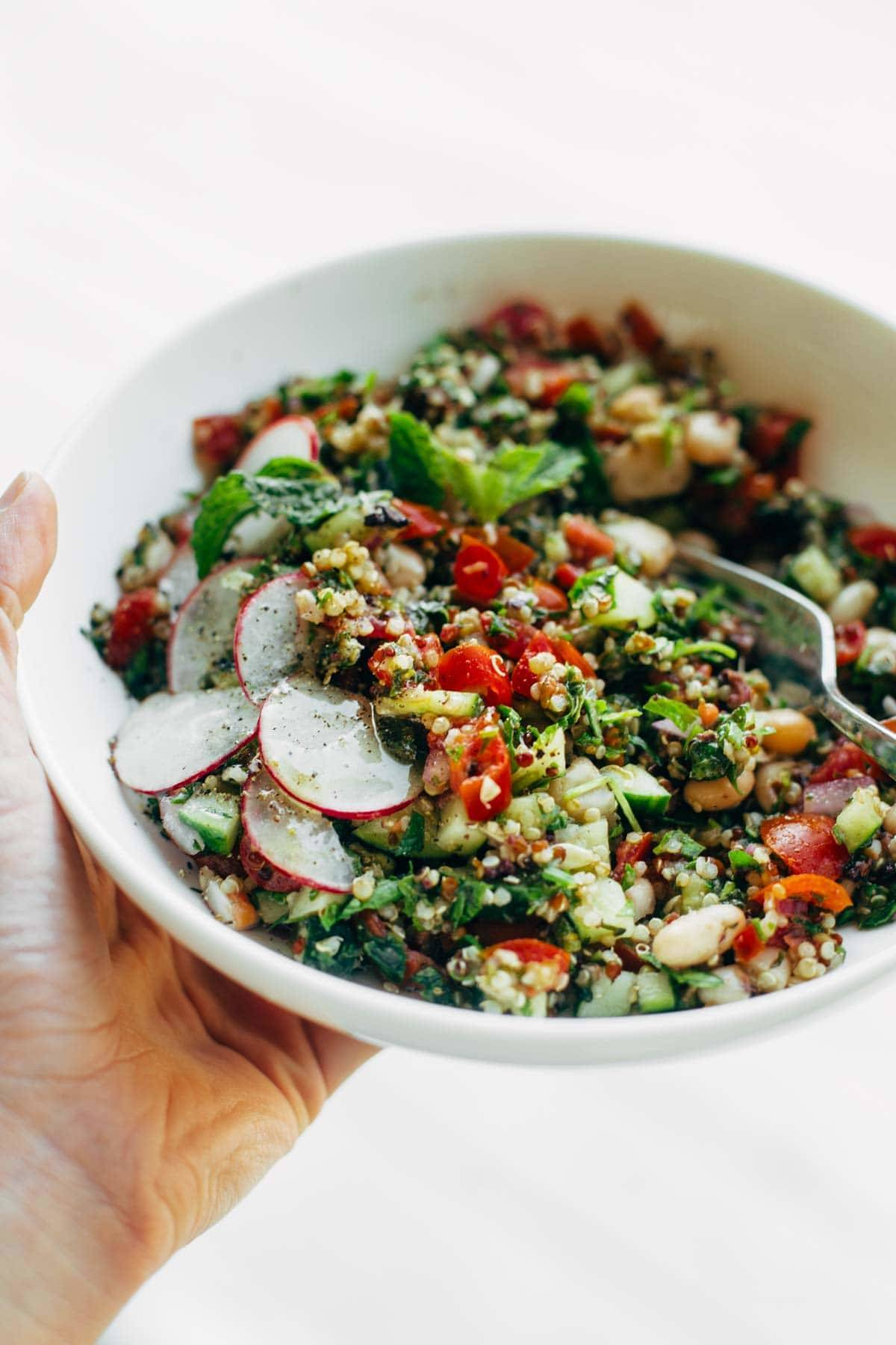 Chopped Greek Salad - clean eating with TONS of flavor! cucumbers, tomato, red onion, mint, parsley, quinoa, and a lemon olive oil drizzle! vegan, vegetarian.   pinchofyum.com