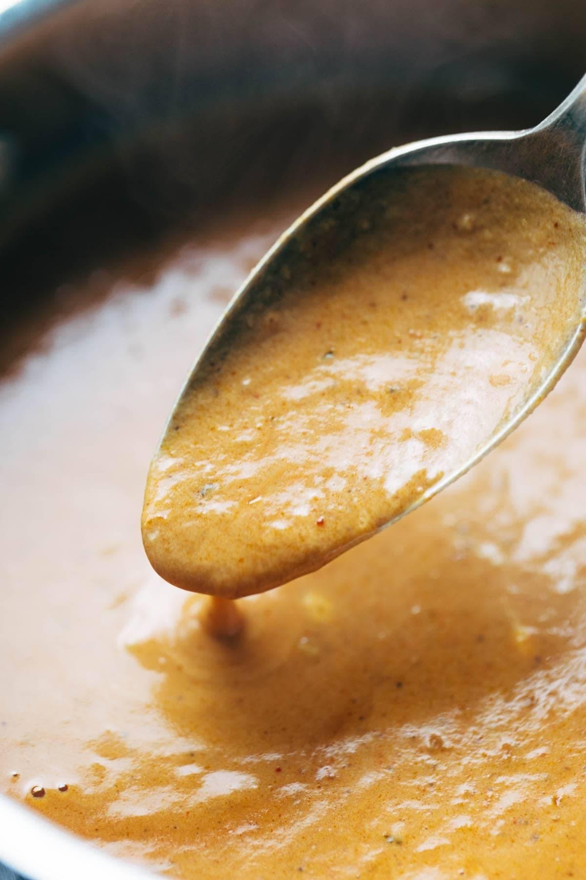 30 Minute Masala Sauce! made with onions, garlic, turmeric, cumin, chili powder, lemon juice, cilantro, tomato puree, and coconut milk. Perfect sauce for veggie or chicken tikka masala! Vegetarian / Vegan.  pinchofyum.com