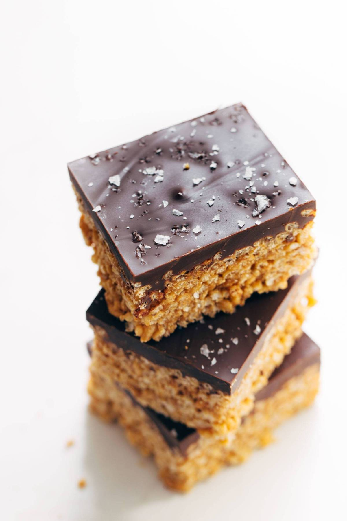 Chocolate-covered peanut butter rice krispie bars stacked on each other.