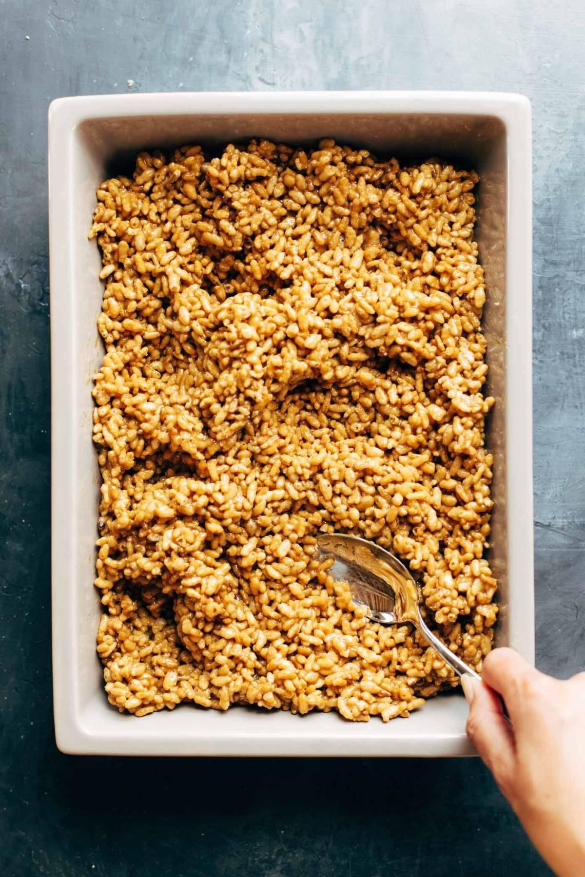 Peanut butter rice krispie bars in a pan.