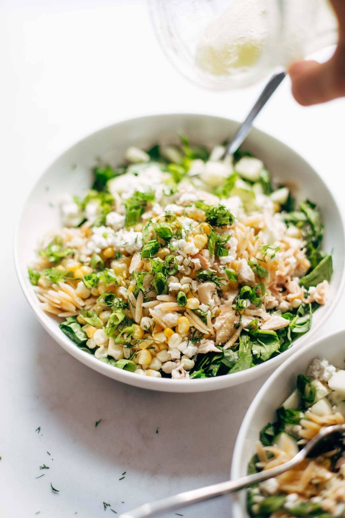 Orzo Summer Salad! With chicken and orzo, loaded with fresh veggies, and finished with a zippy lemon dressing and goat cheese. | pinchofyum.com