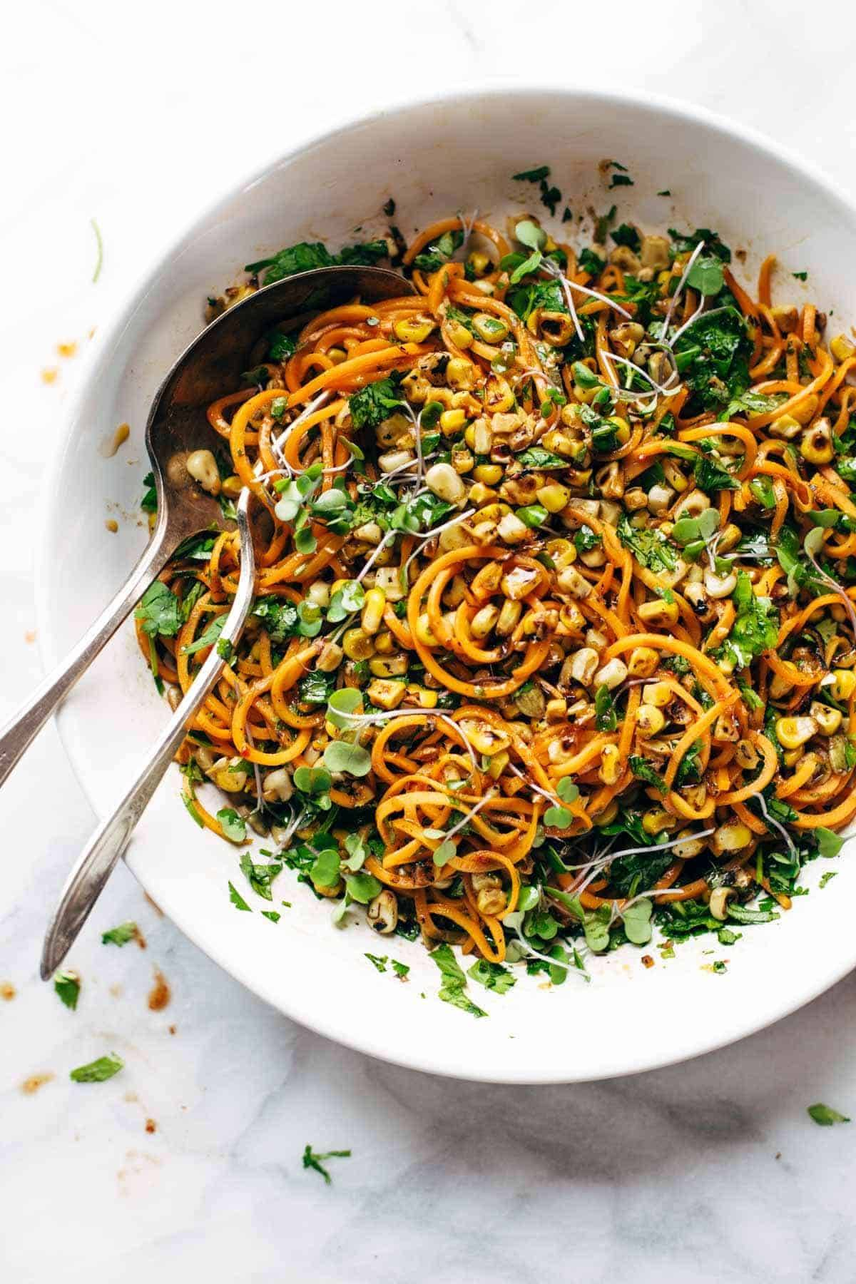 Chipotle Sweet Potato Noodle Salad with Roasted Corn - SUPER good real food salad with a short ingredient list! Cilantro, sweet potato, roasted corn, pepitas, and a homemade chipotle garlic dressing. vegan / vegetarian. | pinchofyum.com
