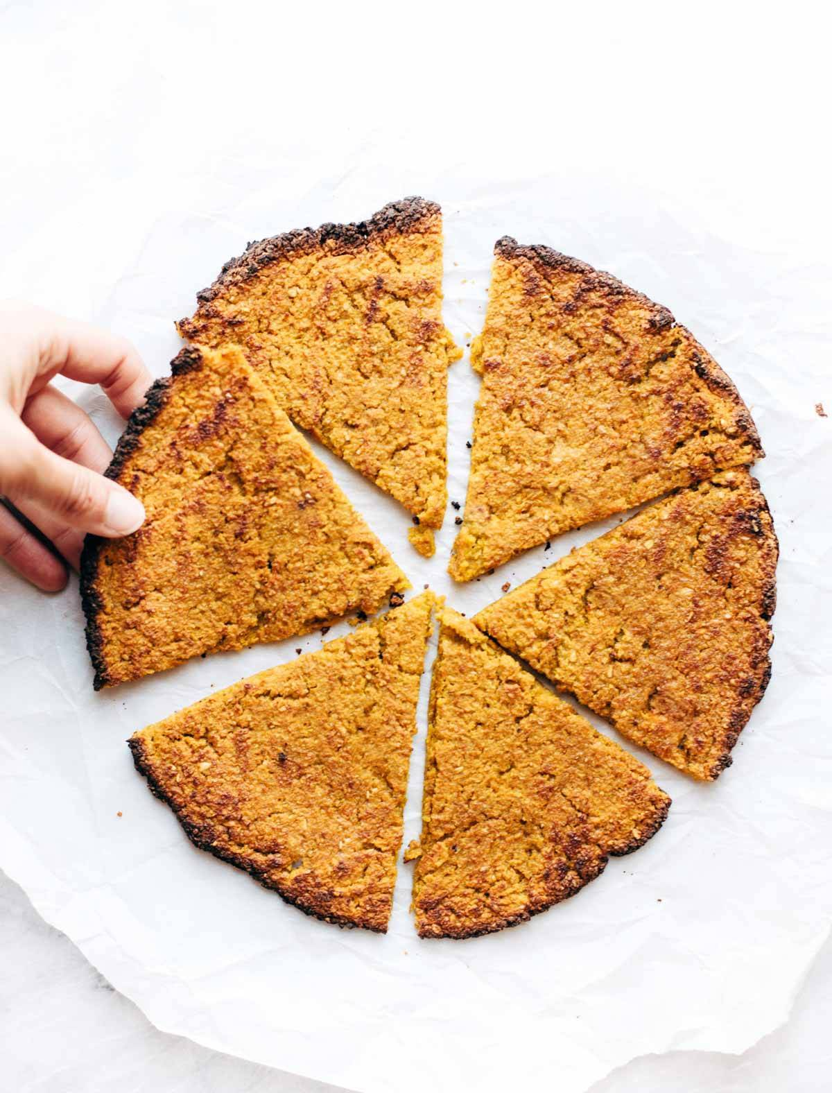 3 ingredient sweet potato pizza crust - all you need is sweet potatoes, rolled oats, and an egg. SUPER easy hand-holdable healthy pizza crust! | pinchofyum.com