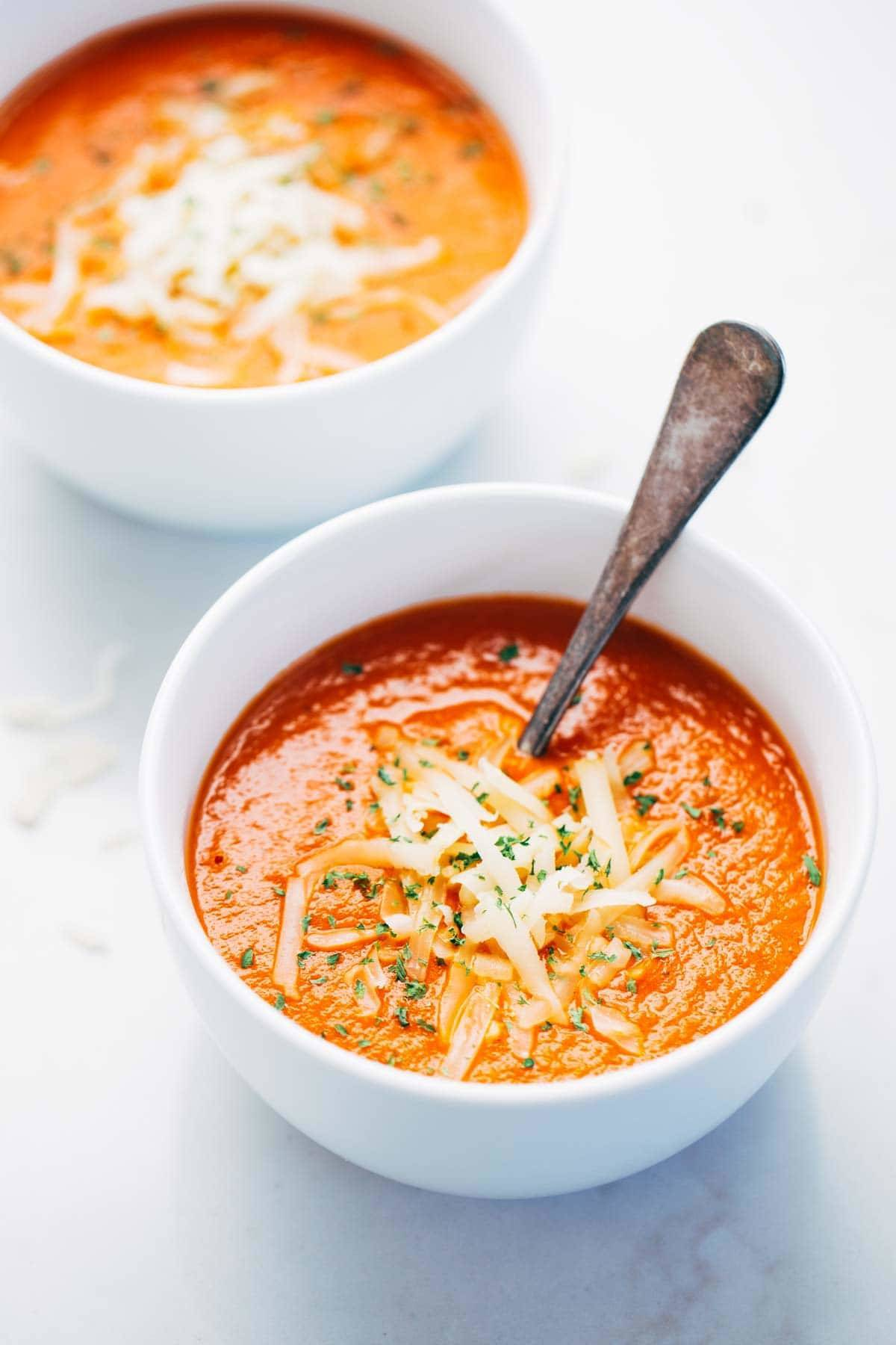 Simple Homemade Tomato Soup with carrots, onions, garlic, tomatoes, broth, and bacon for deliciously rich flavor. Extremely easy to make!   pinchfoyum.com