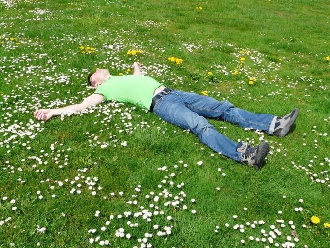 man-relaxing-in-a-field