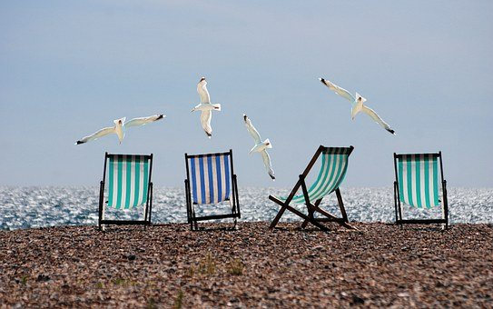 An image of chairs at the beach on vacation.