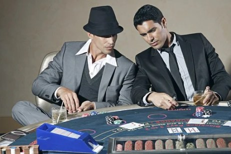 Two gentlemen in a casino betting