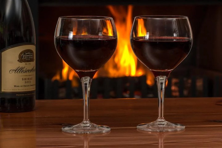 red wine glasses in front of fireplace