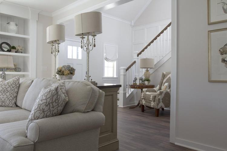living room showing white painted walls with warm colored accents
