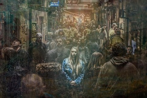 selective focus photography of woman surrounded by people in the street, anxiety, stress, pleasure
