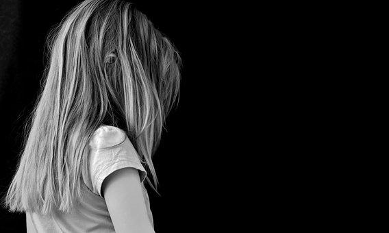 grayscale photography of a girl facing at the back
