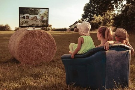 Family watching tv. How to save money on cable television with At &T