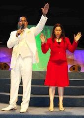 Chris and Anita Oyakhilome during a church service
