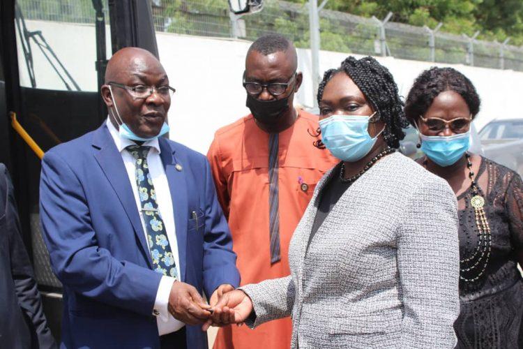 The Permanent Secretary, Public Service Office, Mr. Samson Ajibade handing over the key of a new bus to the Chief Registrar, Lagos High Court, Mrs. Adeyemi Okunuga.