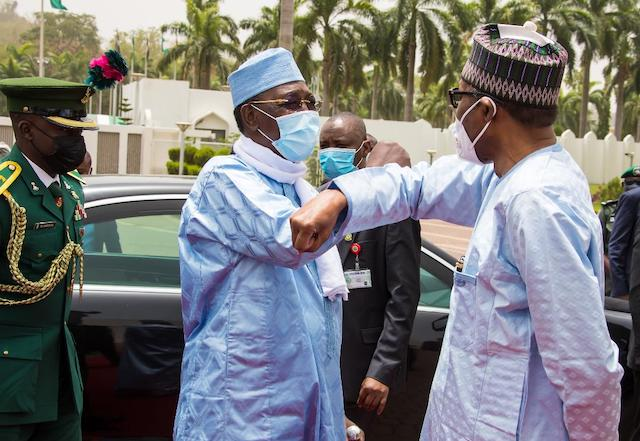 Bye for now: Idriss Deby seemed to say to President Buhari