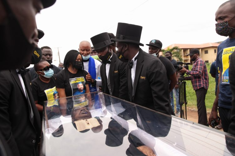 Pall-bearer arrived with the remains of Odumakin at Police College