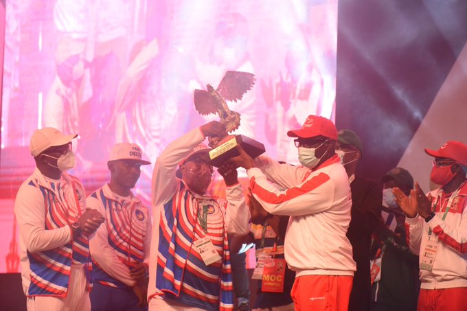 Champion Delta receives the trophy for winning 2020 National Sports Festival
