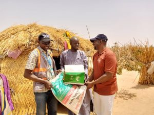 NEMA officials giving out relief material to beneficiary