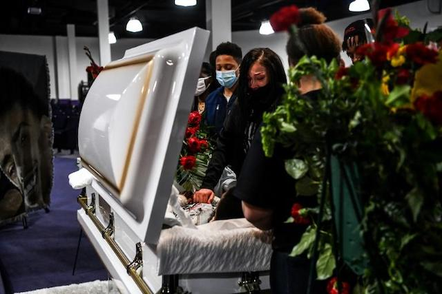 Daunte Wright's mum Katie sobs by the casket of the son