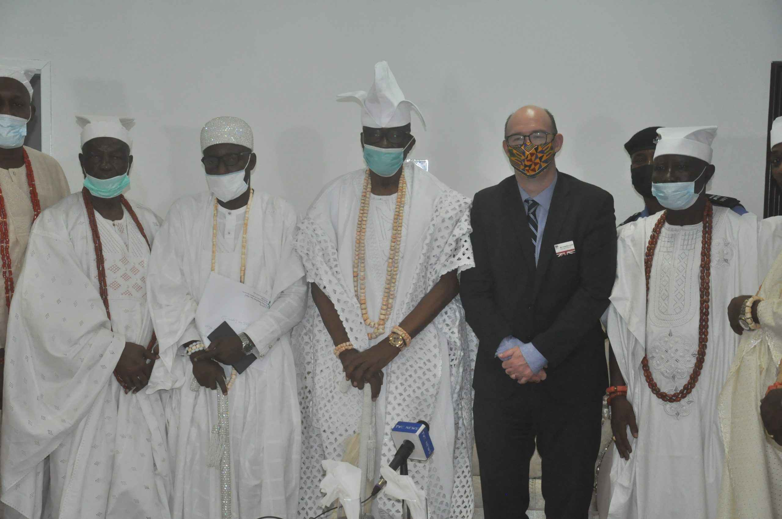 Oba of Lagos, HRM Babatunde Akiolu, British Deputy High Commissioner, Ben Llewellyn-Jones and White Cap Chiefs during the courtesy visit of the Commissioner to Iga Idunganran Palace.