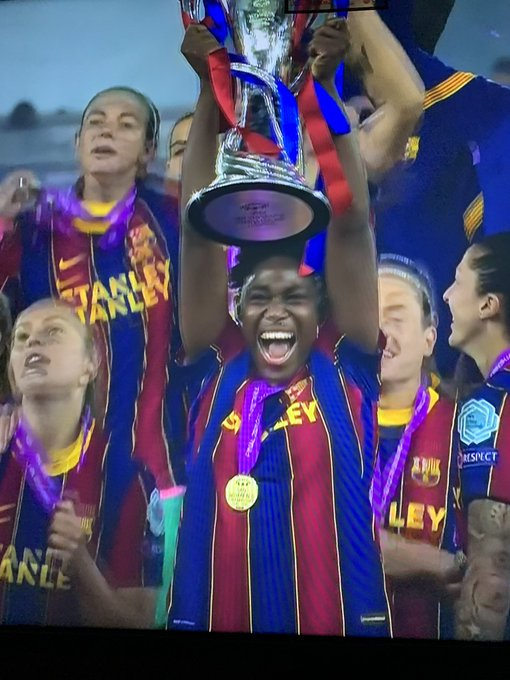 Asisat Oshoala with the Champion League trophy