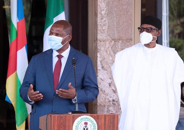 Buhari and President of Central African Republic (CAR) H.E Prof Faustine Archange Touadera face the media
