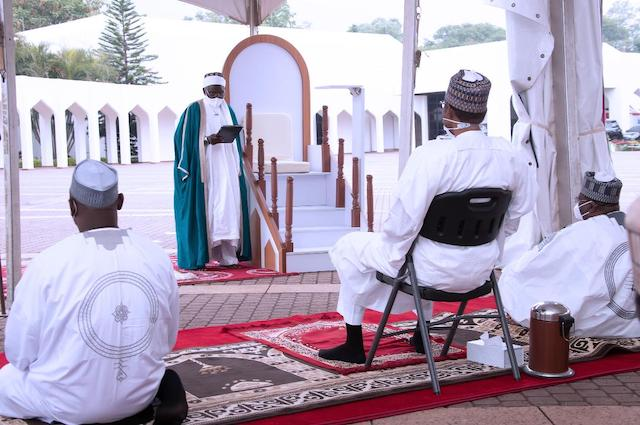 Buhari listens to the sermon by Imam Sulaiman