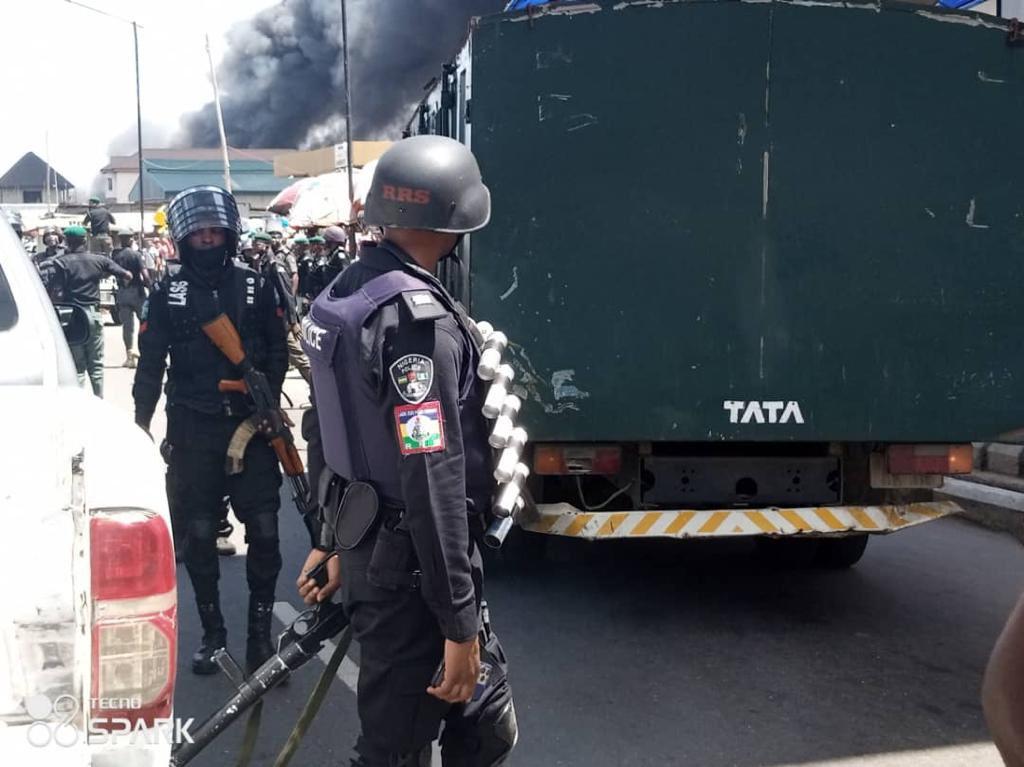 Policemen keeping the peace at Ile-Epo Market
