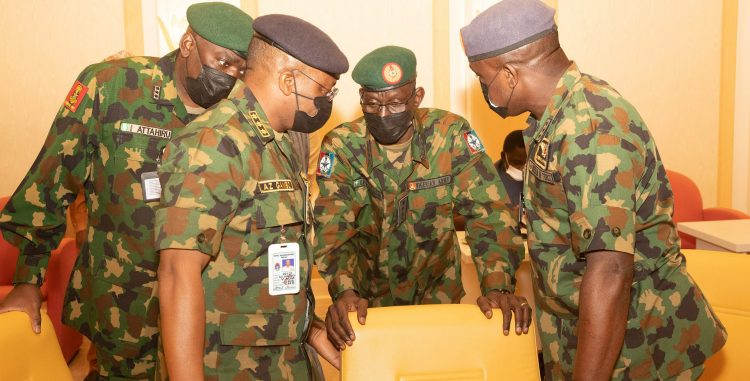 L-R: Security chiefs brainstorm during a security meeting presided over by President Buhari in Abuja. PHOTO; SUNDAY AGHAEZE.