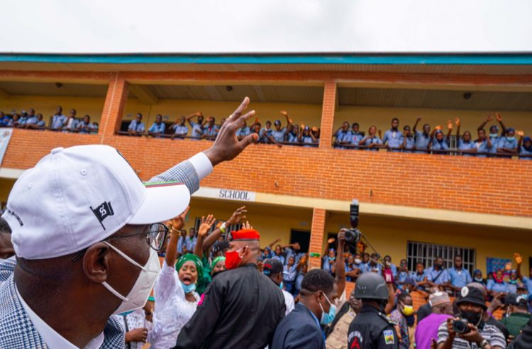 Lagos State Governor, Mr. Babajide Sanwo-Olu; acknowledging cheers from students during the commissioning of block of classrooms in Lagos Schools as part of the State's Schools Infrastructure projects, on Thursday, May 6, 2021.