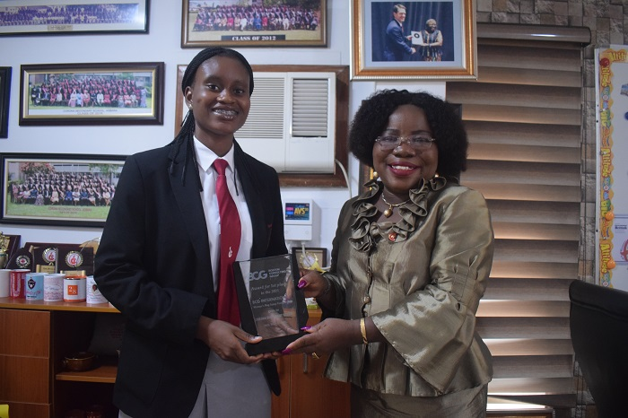 (L-R) Tamaramiebi Akika, Winner, BCG IWD's essay competition with Mrs Chinedum Oluwadamilola,  Principal, Corona Secondary School, Agbara during the presentation of prizes recently in Lagos.