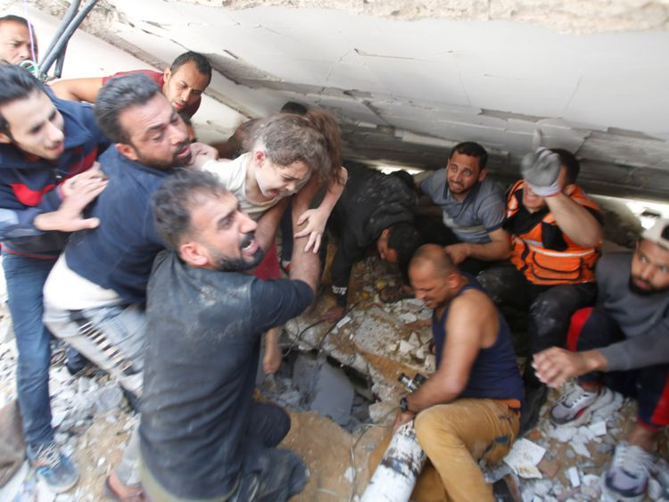 rescuers pull a girl from the rubble after Israeli air strike in Gaza