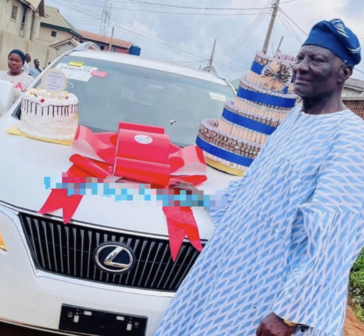 Bobrisky's father with his car