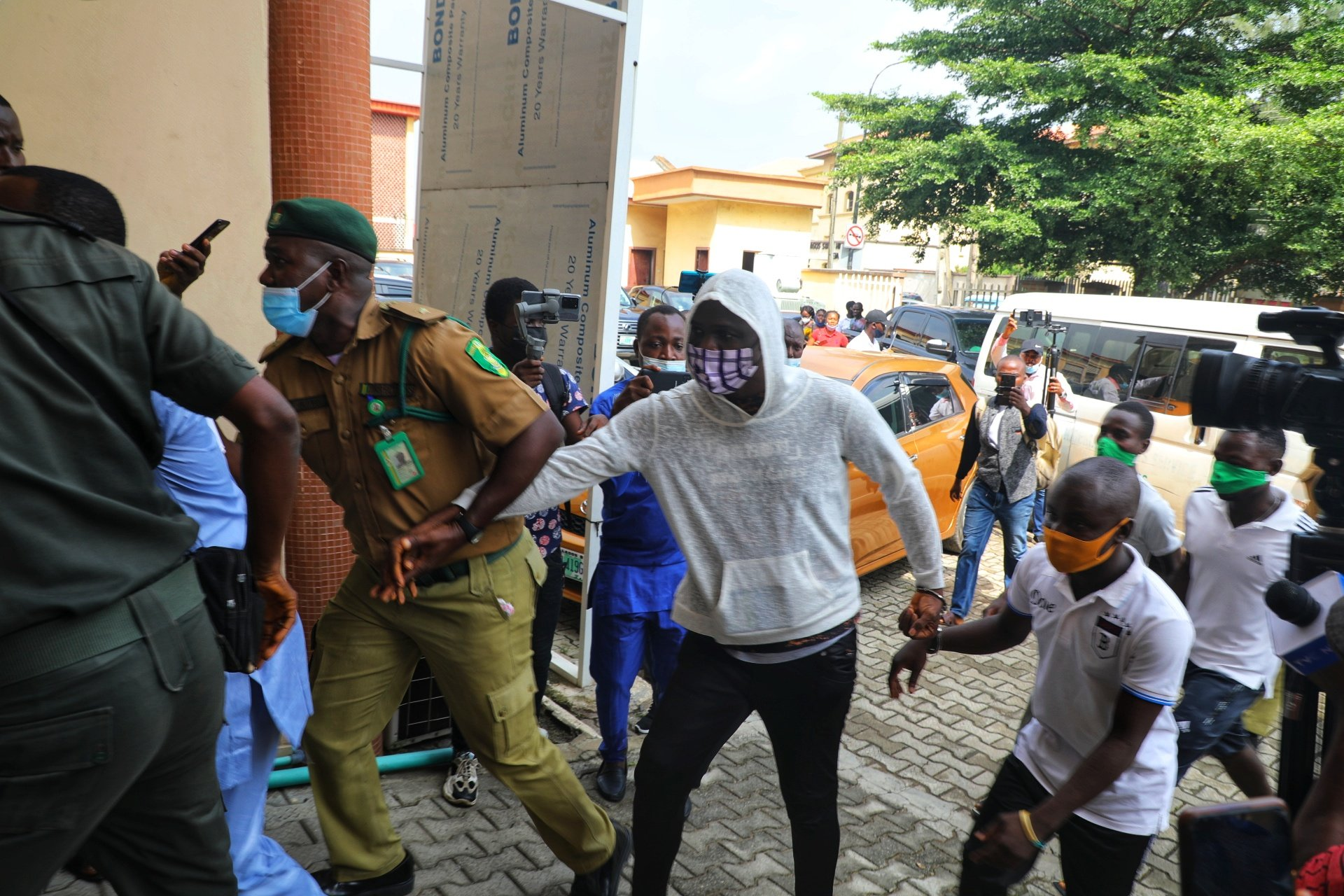 Baba Ijesha was dragged into the court by a prison warder to avoid pressmen