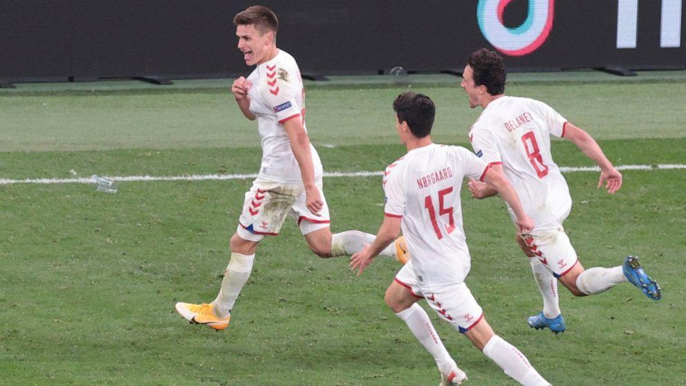 Denmark's Joakim Maehle celebrates Denmark's 4th goal against Russia in Euro 2020