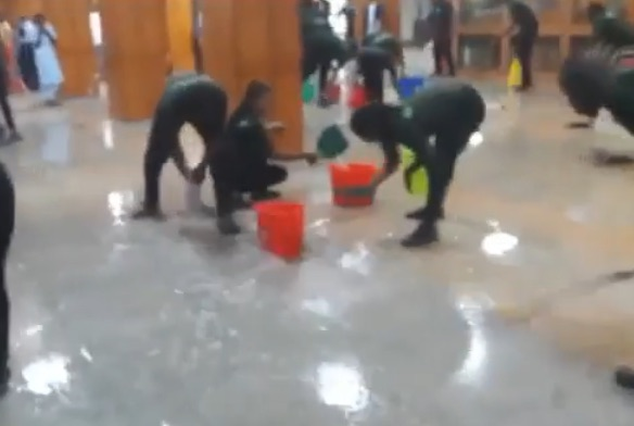 National Assembly cleaners mop rain drenched area of the Senate