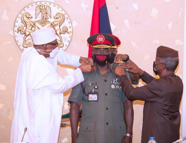 Buhari and Osinbajo decorate Lt. General Faruk  Yahaya, chief of army staff