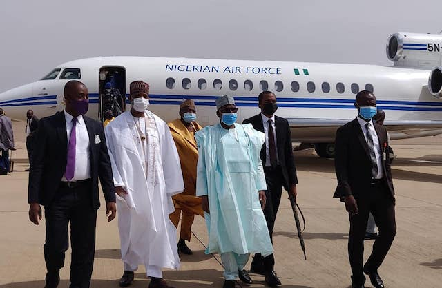 Gambari, middle, with Presidential team  after landing in Kano