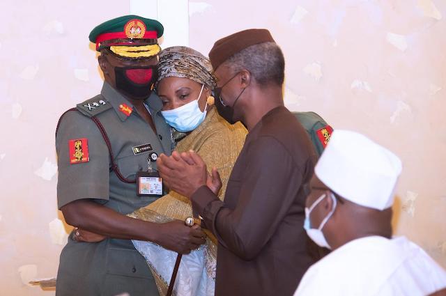 Lt.General Faruk Yahaya with his wife, cheered by Osinbajo