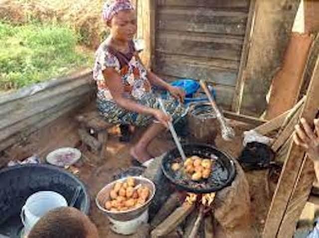 A woman fries Akara or bean cake outside Chukuku in Abuja