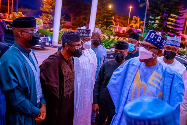 Buhari welcomed to  the dinner by his guests