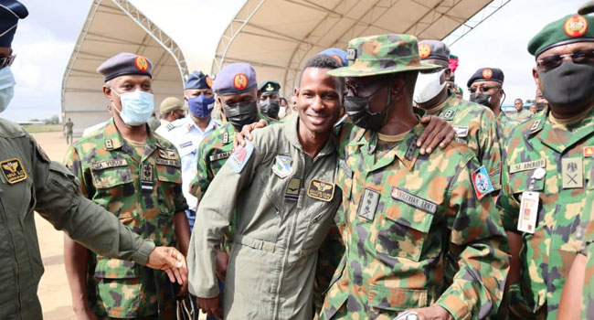 Flight Lieutenant Abayomi Dairo with the Chief of Defence Staff, Lucky Irabor, and other military officials.