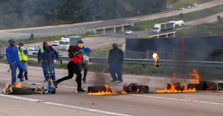 Rioters block a major road for Zuma