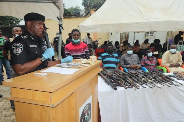 Police Commissioner Frank Mba with the 39 suspects paraded on Monday