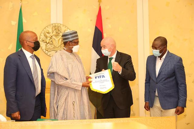 Buhari gets the FIFA flag from Infantino