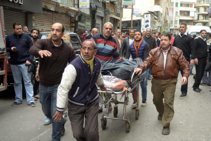 2017-04-09 13:21:28 Egyptians wheel away a body near a church in Alexandria after a bomb blast struck worshippers gathering to celebrate Palm Sunday on April 9, 2017. The Interior ministry said Coptic Pope Tawadros II was inside the church leading a Palm Sunday service when the suicide bomber was stopped by police outside and blew himself up. A church official said Tawadros had already left the church when the bombing took place. / AFP PHOTO / STRINGER