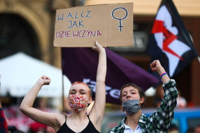 Women in Poland protesting against domestic violence. They want better protection from the government.