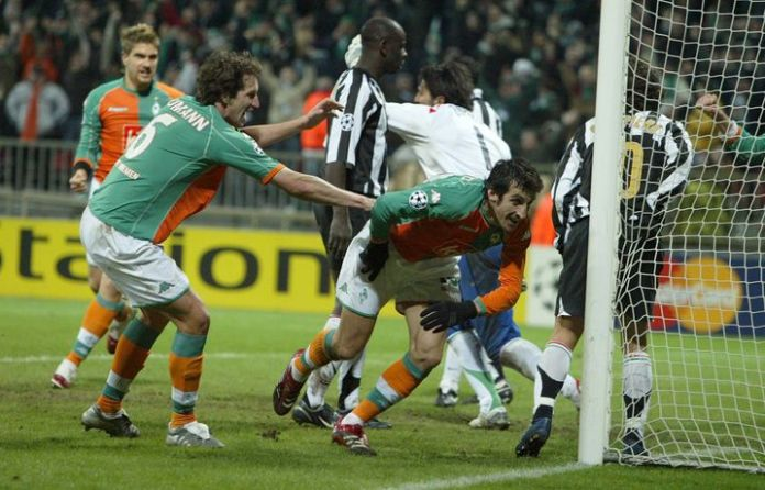 Frank Baumann (left) in Bremen's 3-2 victory over Juventus in 2006. Here he cheers with Johan Micoud